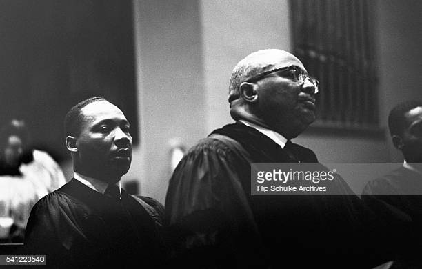 Reverend Martin Luther King Jr listens to a sermon behind his father Martin Luther King Sr the pastor at Ebenezer Baptist Church