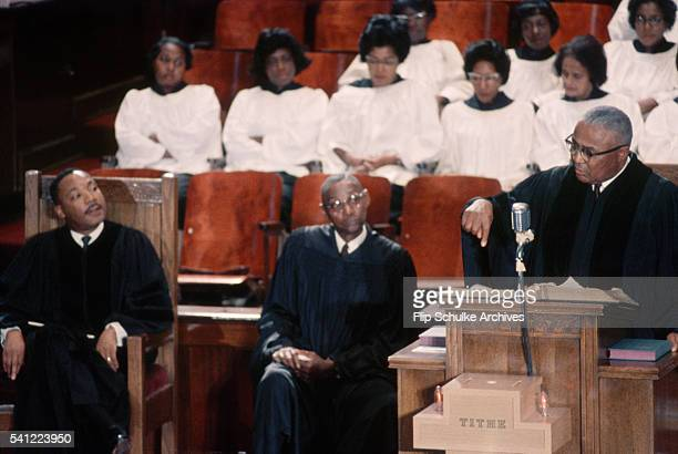 Reverend Martin Luther King Jr listens to a sermon by his father Martin Luther King Sr at Ebenezer Baptist Church November 8 1964 Another clergyman...