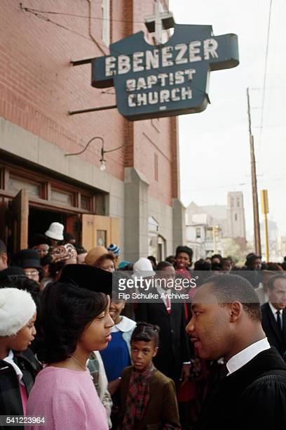 Reverend Martin Luther King Jr meets his parishioners at Ebenezer Baptist Church after Sunday services end