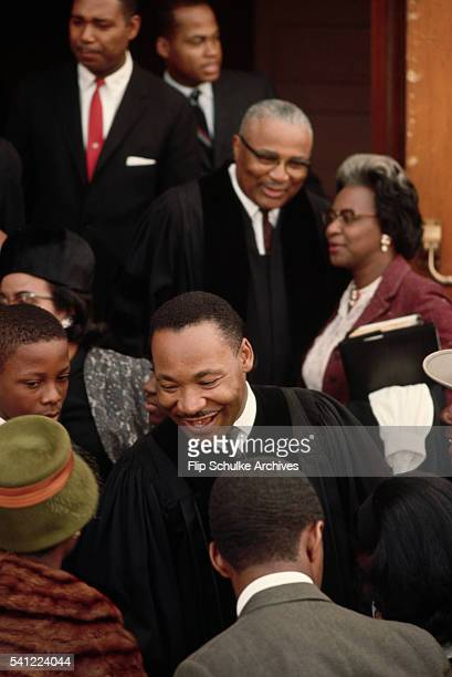 Reverend Martin Luther King Jr meets his parishioners at Ebenezer Baptist Church after Sunday services end His father the main pastor of the church...