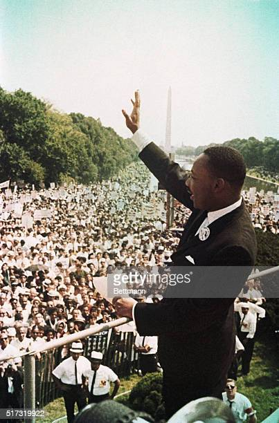 Reverend Martin Luther King Jr waves to participants in the Civil Rights Movement's March on Washington August 28 1963