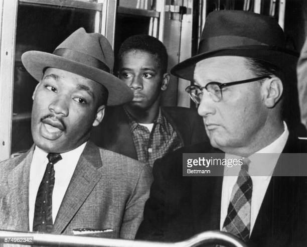 Reverend Martin Luther King leader of the Montgomery Bus Boycott that started about a year ago is shown riding a Montgomery Bus up front with the...
