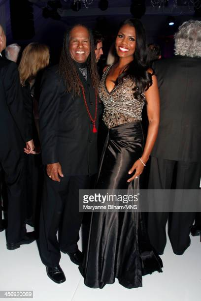 Reverend Michael Beckwith and Omarosa Manigault attend the wedding of Michaele Schon and Neal Schon at the Palace of Fine Arts on December 15 2013 in...