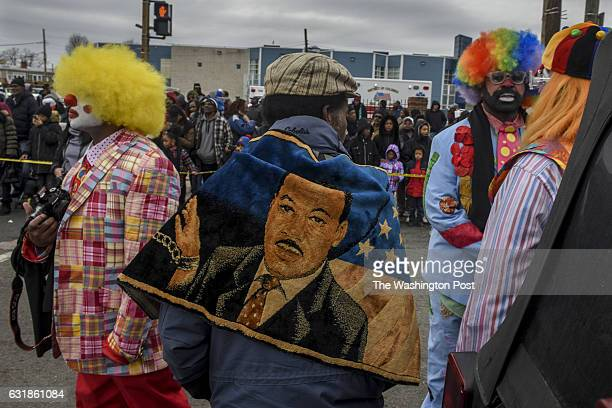 Reverend Moses Williams sports a wrap that bears the image of Martin Luther King Jr as the 11th Annual MLK Peace Walk and Parade makes its way up...