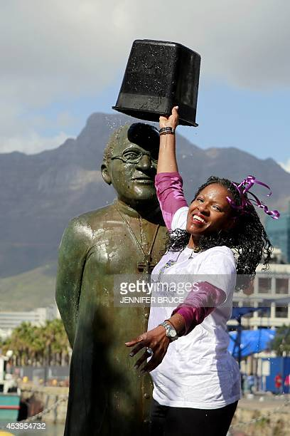 Reverend Mpho Tutu CEO of the Desmond and Leah Tutu Foundation empties a bucket of ice and water onto a statue depicting her father Archbishop...
