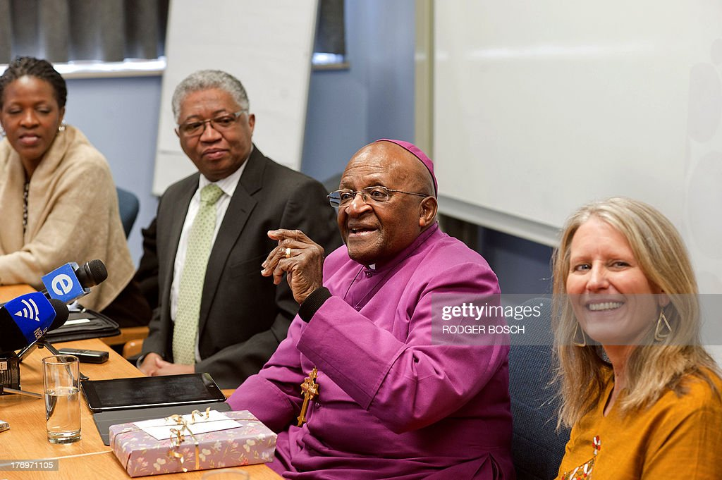 Reverend Mpho Tutu, Vice Chancellor of the University of Stellenbosch Professor Russel Botman Nobel Prize Peace Laureate Archbishop Desmond Tutu and Cynthia Brix of Gender Reconciliation International attend the launching ceremony of a partnership between Tutu's foundation and other organizations at the University of Stellenbosch Medical School, on August 20, 2013, in Bellville, Cape Town. The partnership between the Desmond and Leah Tutu Legacy Foundation, Stellenbosch University, and Gender Reconciliation International will focus on the implementation of gender reconciliation, applying principles of South Africas truth and reconciliation process to restore peoples faith in one another.