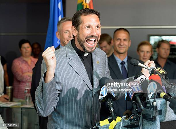 Reverend Neil Thomas of California Faith for Equality celebrates during a news conference at the West Hollywood City Hall after the US Supreme Court...