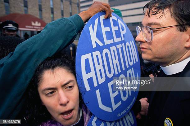 Reverend Paul Schenck of the antiabortion group Operation Rescue argues with prochoice supporters during an abortion rights protest in Buffalo One...