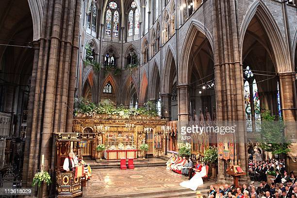 Reverend Richard Chartres Lord Bishop of London reads from the pulpit at Westminster Abbey during the royal wedding of Prince William and Kate...