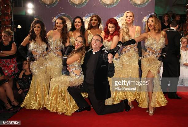 Reverend Richard Coles poses with female professional dancers at the 'Strictly Come Dancing 2017' red carpet launch at The Piazza on August 28 2017...