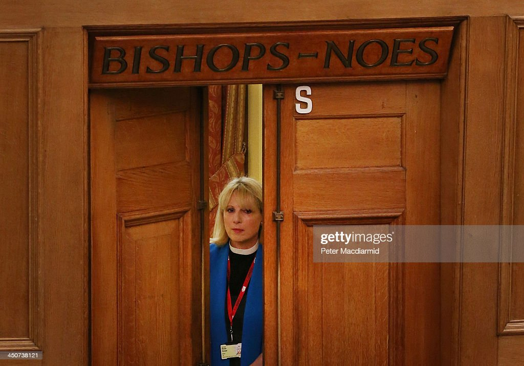 Reverend Rosie Harper stands in the doorway of the now unused 'Bishops Noes' voting lobby before speaking to the general Synod on November 20, 2013 in London, England. The Church of England's governing body has voted for a proposal which may allow the ordination of woman as bishops in 2014.