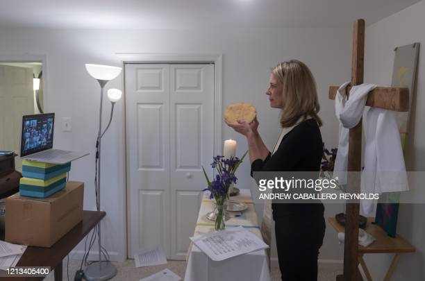 TOPSHOT Reverend Sarah Scherschligt Pastor at the Peace Lutheran church holds communion during an online streaming service from the basement of her...