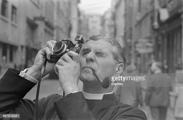 Reverend William Baddeley taking a picture of the new fiberglass spire on top of St James's Church Piccadilly London 1968