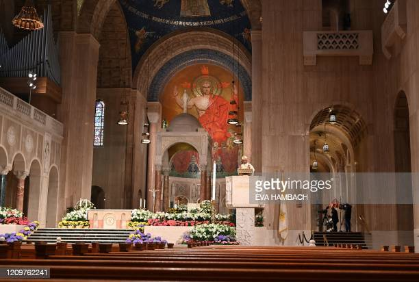 Reverend Wilton D Gregory Archbishop of Washington celebrates an Easter Sunday mass in front of empty pews at the Basilica of the National Shrine of...