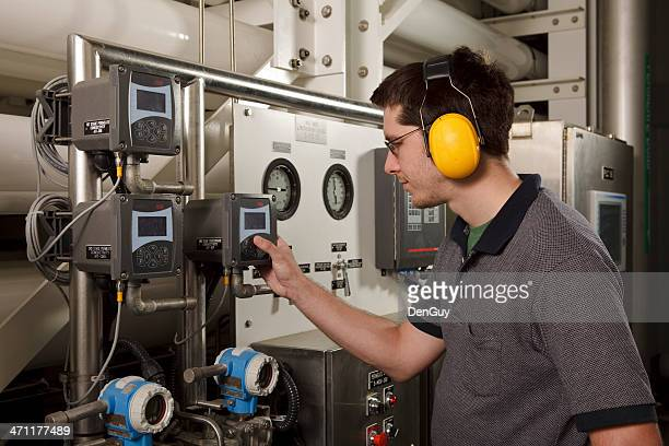 Reverse Osmosis Water Purification Plant Technician Checks System Settings