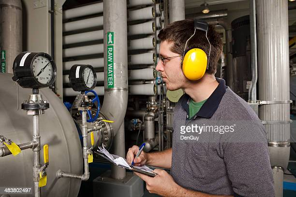 reverse osmosis water purification plant technician checks system settings - sewer stock pictures, royalty-free photos & images