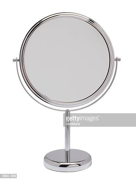 Reversible makeup mirror on stand