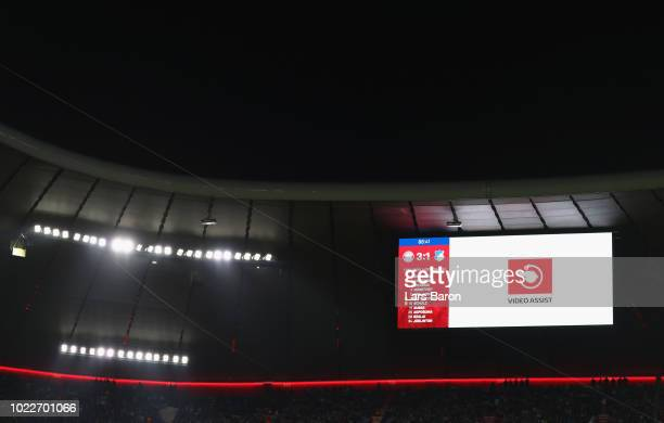 VAR review is displayed on the scoreboard during the Bundesliga match between FC Bayern Muenchen and TSG 1899 Hoffenheim at Allianz Arena on August...