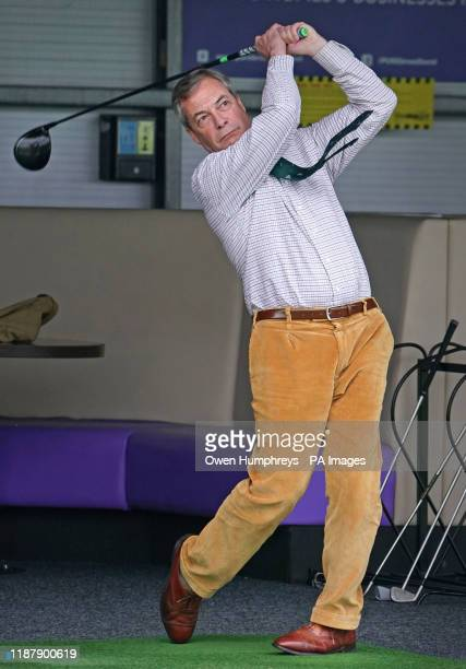 PA Review of the General Election 2019 28/11/19 Brexit Party leader Nigel Farage playing golf on a range at One Stop Golf in Hull East Yorkshire