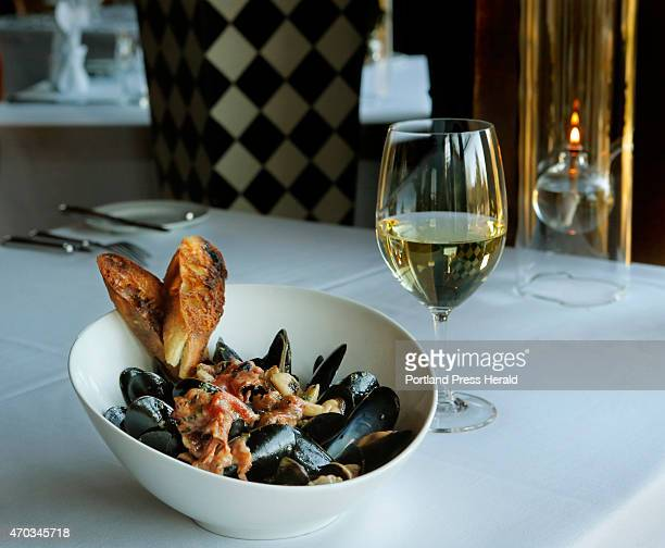 Reviewer James Schwartz says the appetizer of panroasted rope cultured mussels at On the Marsh are among the best he has ever had They are served in...