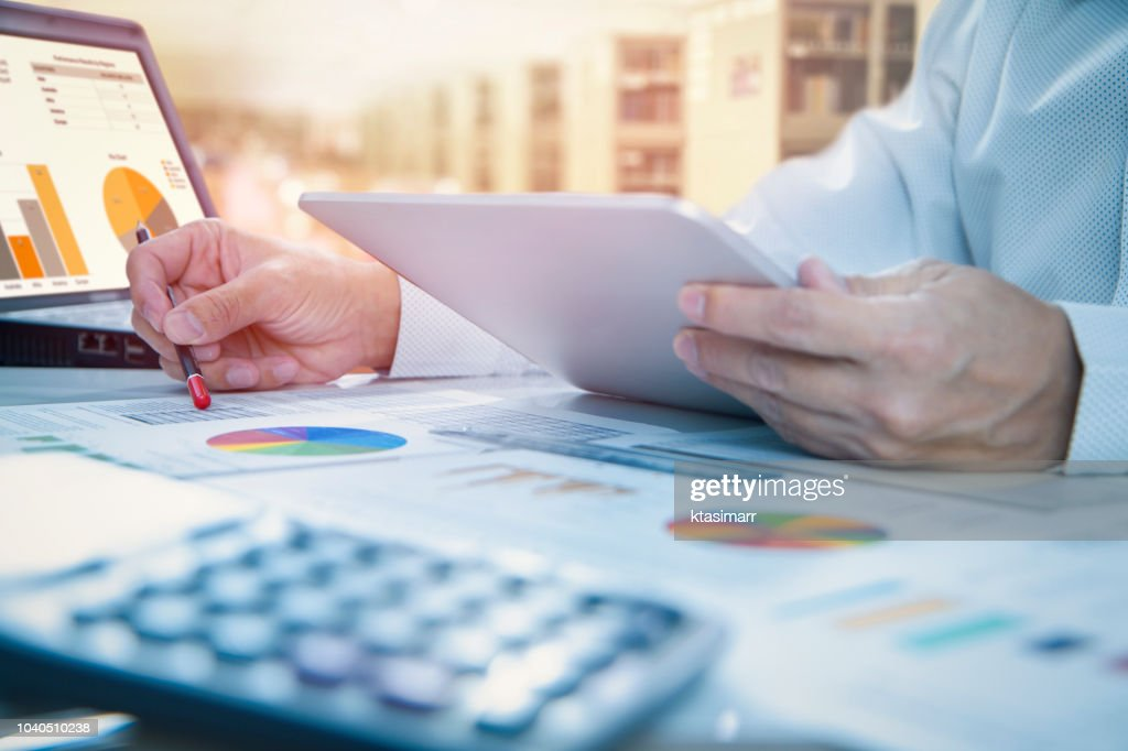 Reviewing a financial report in returning on investment analysis : Stock Photo