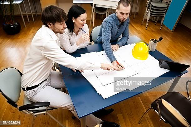 Reviewing blueprints in the office