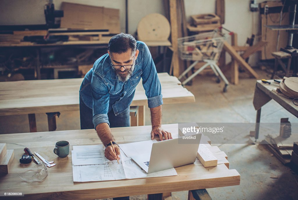 Reviewing the project details : Stock Photo