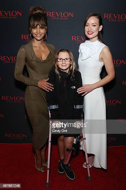 Revlon Global Brand Ambassador Halle Berry Perry Zimmerman and Revlon Global Brand Ambassador Olivia Wilde celebrate the Revlon LOVE IS ON Million...