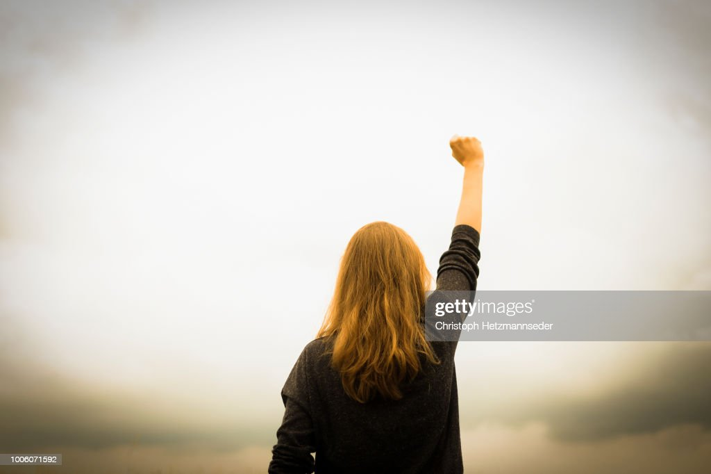Revolution fist raised : Stock Photo