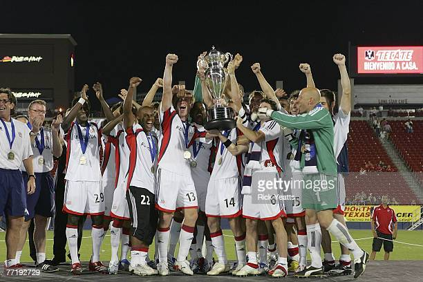Revolution players and coaches celebrate their 32 victory over FC Dallas after the 2007 Lamar Hunt US Open Cup Final on October 3 2007 at Pizza Hut...