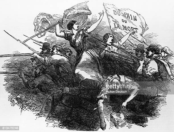 Revolutionaries armed with rifles man the barricade at Port St Denis while two women wave flags The flag on the right states 'Du Pain ou la Mort'
