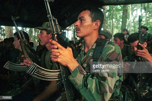 Revolutionary Armed Forces of Colombia guerrillas prepare plans to set up road blockades February 28 2002 in Caqueta jungle Colombia Peace talks with...