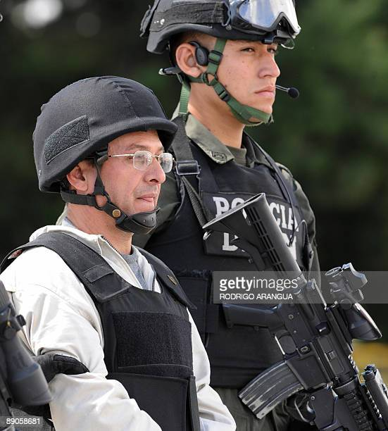 Revolutionary Armed Forces of Colombia member Gerardo Aguilar aka Cesar is being escorted by a Colombian police officer before being extradited to...