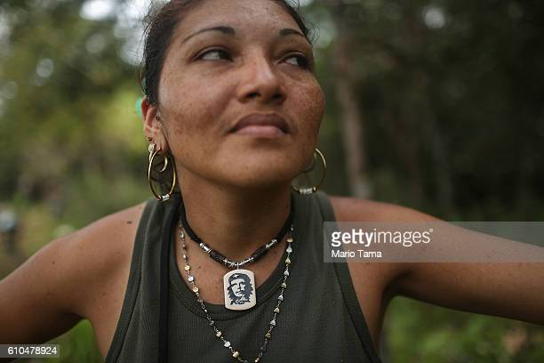 Revolutionary Armed Forces of Colombia rebel Gina poses while wearing her Che Guevara necklace following the 10th Guerrilla Conference in the remote...