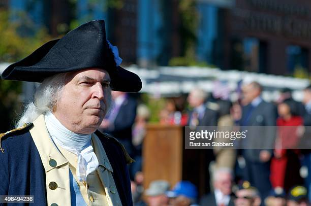 revolutionary army reenactor at philly veterans day parade - revolutionary war soldier stock photos and pictures