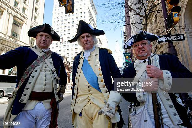 revolutionary army reenactors at philly veterans day parade - revolutionary war soldier stock photos and pictures
