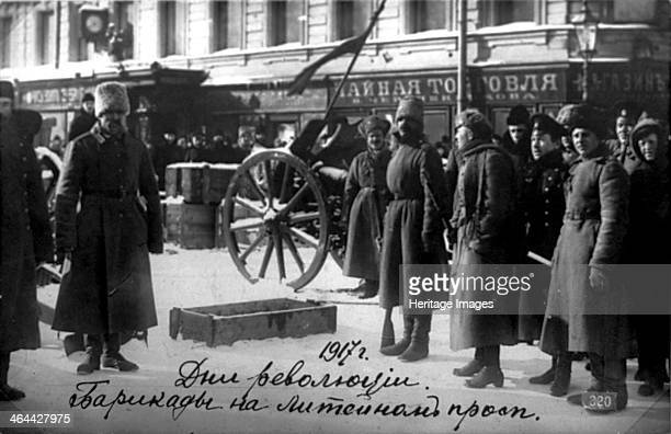 Revolutionary barricades on Liteyny Prospekt Petrograd Russia 27 February 1917 The February Revolution led to the abdication of Tsar Nicholas II and...