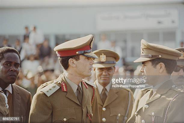 Revolutionary Chairman of the Libyan Arab Republic Muammar Gaddafi pictured 2nd from left with Libyan Minister of Defence AbuBakr Yunis Jabr and...