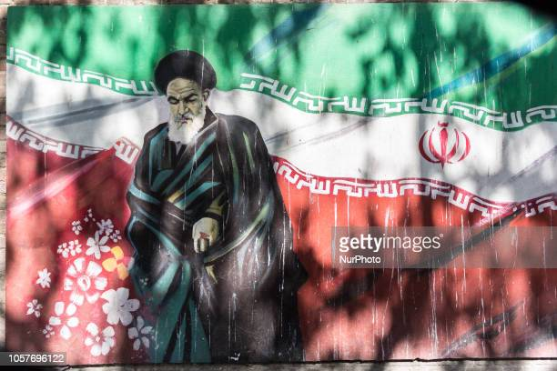 Revolutionary graffiti of Ruhollah Khomeini the first post revolution Ayatollah with Iranian flag as a background on Taleqani Street in Tehran the...