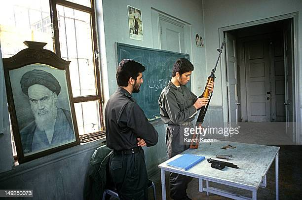 A Revolutionary Guard conducts an arms training session with a Russian Dragunov sniper rifle in a classroom at the former US embassy in Tehran 25th...