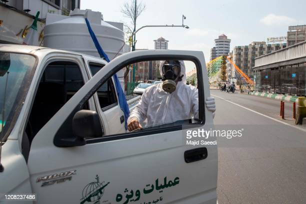 Revolutionary Guard members take part in disinfecting the city on March 25, 2020 in Tehran, Iran. Iran is battling the worst outbreak of coronavirus...