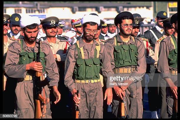 Revolutionary Guard soldiers incl Basidjis Islamic volunteers in their midst leading troops marching in military parade kicking off sacred defense...