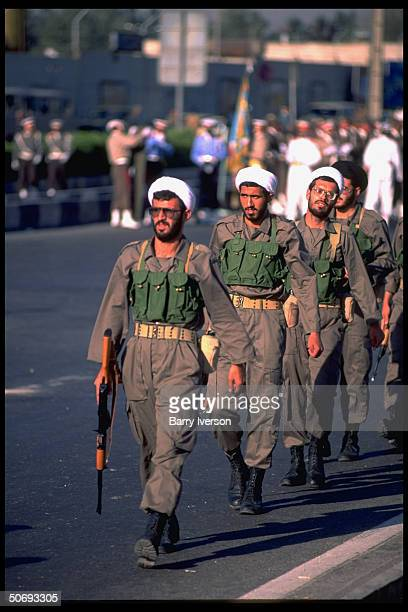 Revolutionary Guard soldiers incl Basidjis Islamic volunteers in their midst marching in military parade kicking off sacred defense week ceremonies...