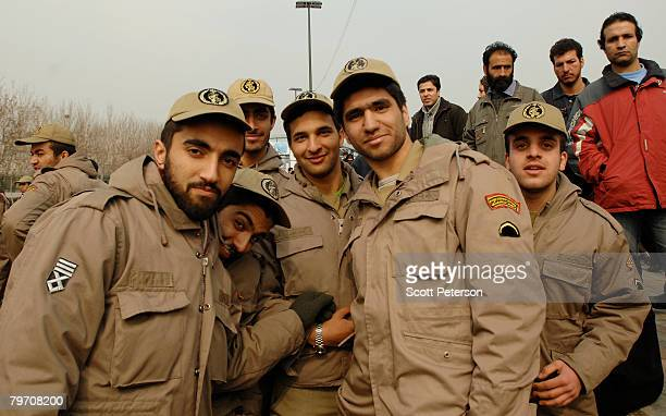 Revolutionary Guard soldiers stand guard as Iranians hold a massive rally to mark the 29th anniversary of Iran's 1979 Islamic revolution on February...