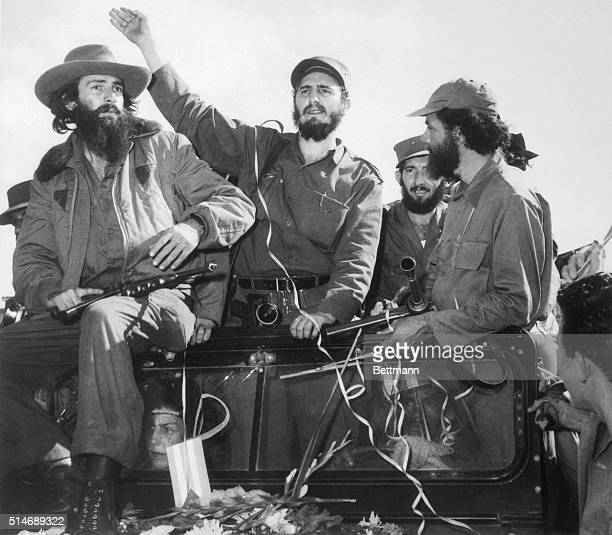Revolutionary leader Fidel Castro waves to a cheering crowd upon his arrival in Havana Cuba after dictator Fulgencio Batista fled the island