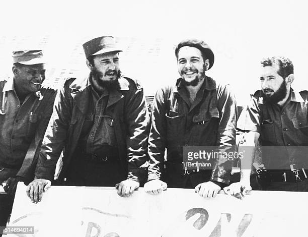 Revolutionary Major Ernesto Che Guevara speaks with Premier Fidel Castro as they review a peasant militia parade at the San Julian Base in Cuba |...