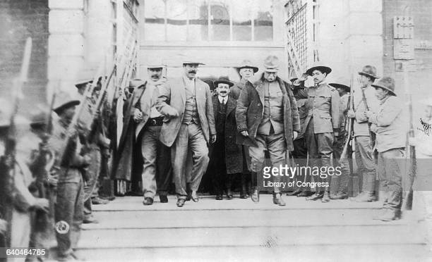 Revolutionary Pancho Villa and US Army General Hugh Scott exiting a building after a conference during the Mexican Revolution