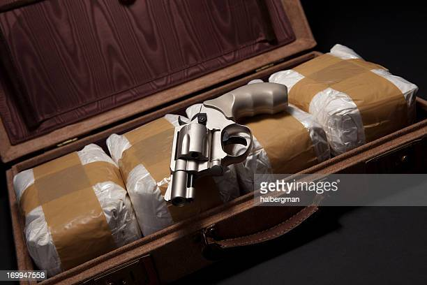 revolver and drugs in a briefcase - crime or recreational drug or prison or legal trial bildbanksfoton och bilder