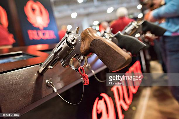 A revolver sits on display in the Sturm Ruger Co Inc booth on the exhibition floor of the 144th National Rifle Association Annual Meetings and...