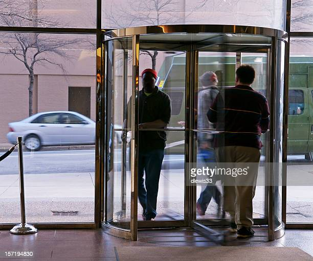 revolving door - revolve stock photos and pictures